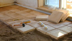 Pictures of Straw Bale House Construction (Part 4): Shooting Lime Stucco Plaster, Installing In