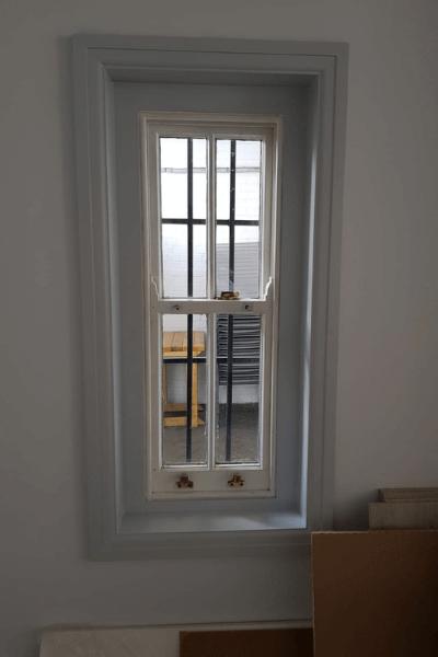 Security window film applied to a ground floor window