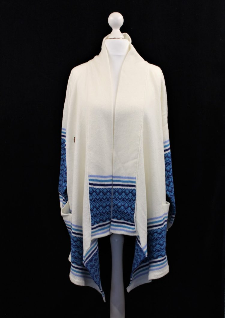 Solasonach marrakech waterfall lambswool cardigan in white and blue against a black background