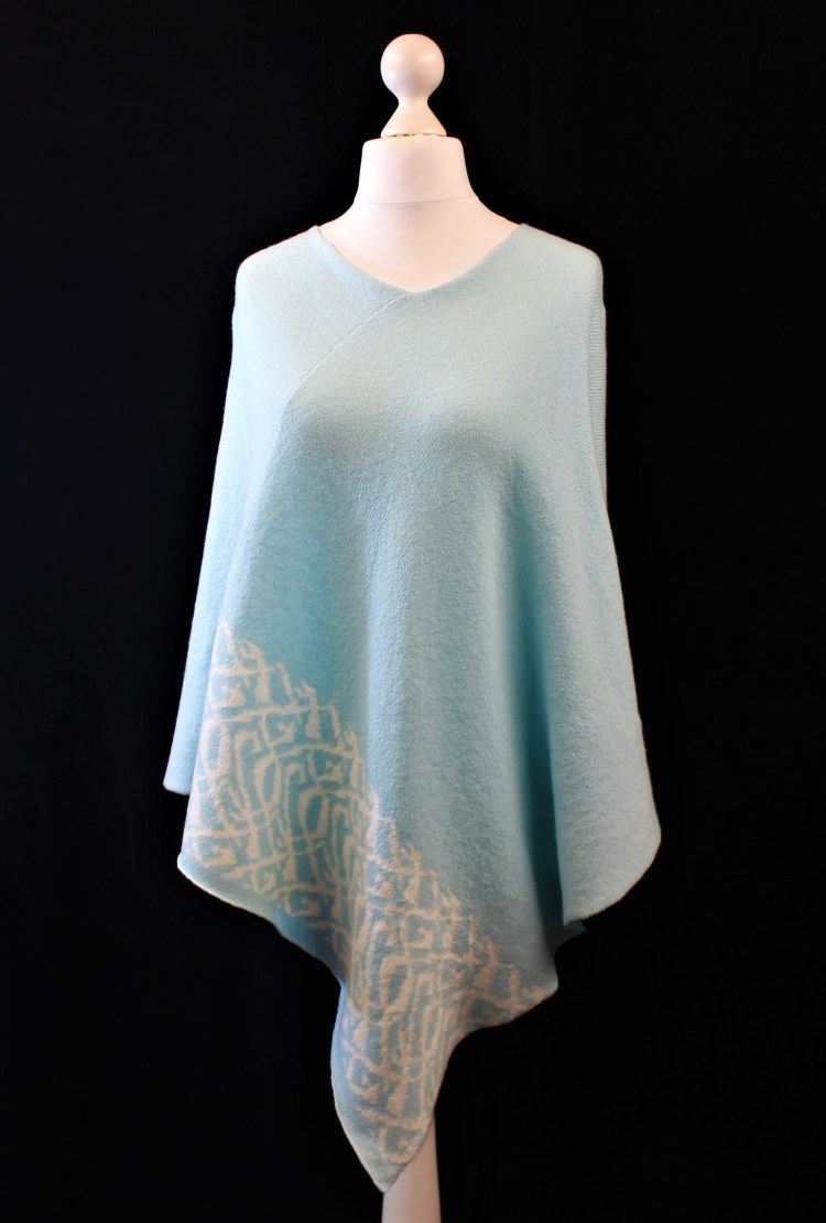Solasonach Lambswool Lunan poncho in pale turquoise and white