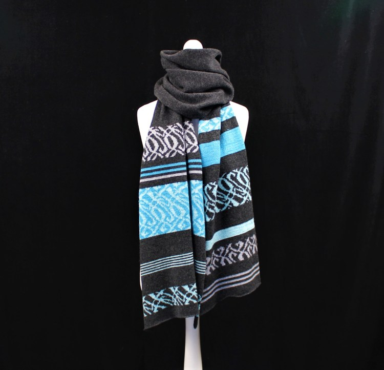 Solasonach Lunan lambswool wrap in charcoal and turquoise blue