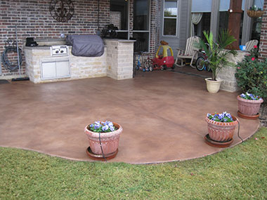 espresso brown stained skim coat overlay on back patio