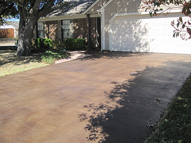 brown acid stained driveway