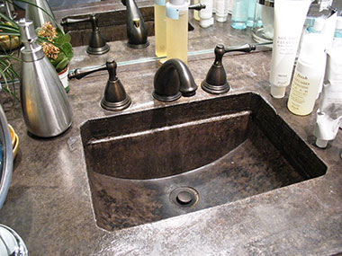 ebony acid stained concrete countertop and sink