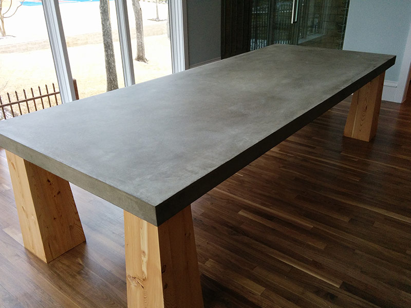 gray concrete table top on wood legs
