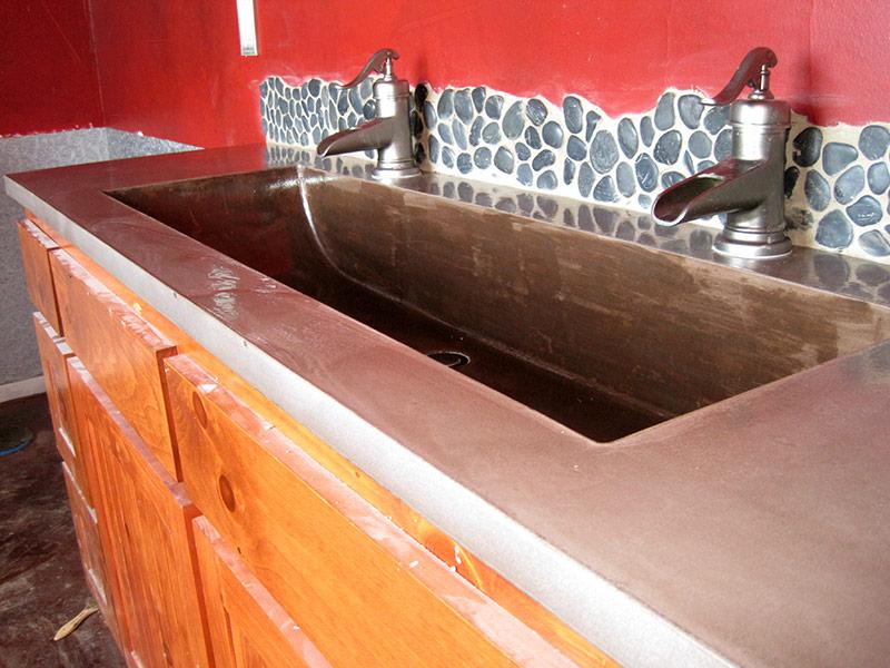 long kahlua colored cement trough sink