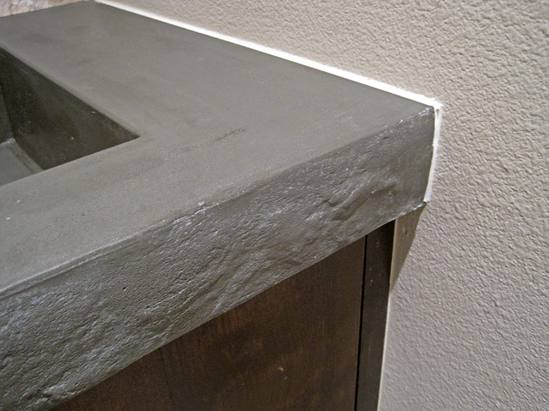 close up of edge of integral concrete sink