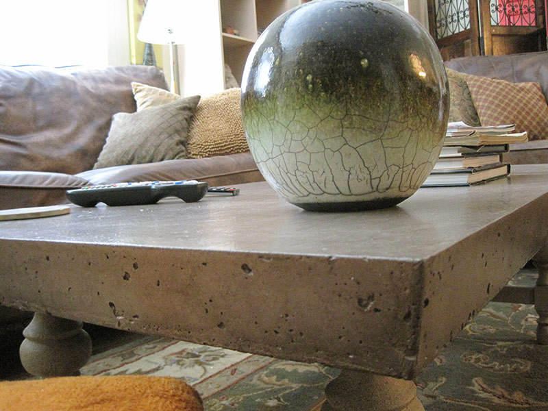 close up of kahlua colored concrete coffee table edge