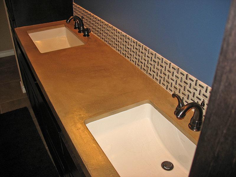 view of both undermount sinks in beige concrete countertop