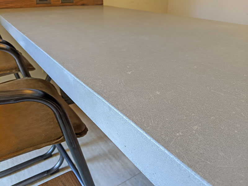 close up of the gray concrete table top