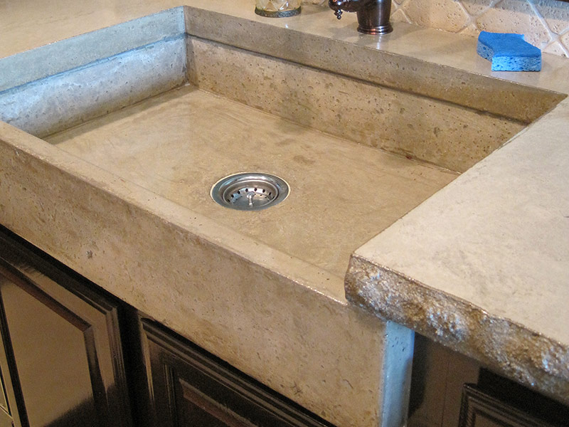 side view of mesa buff concrete farmhouse sink