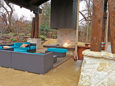 concrete mantle surrounded by patio furniture
