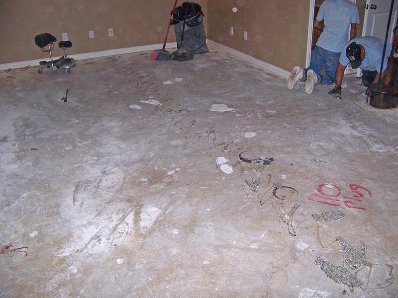 concrete floor with carpet glue lines