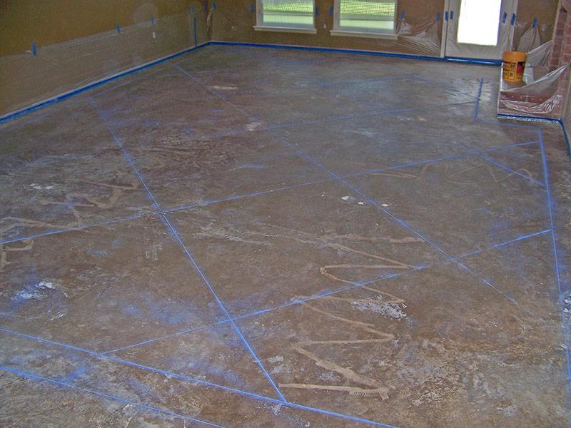 carpet glue lines in concrete floor prior to staining