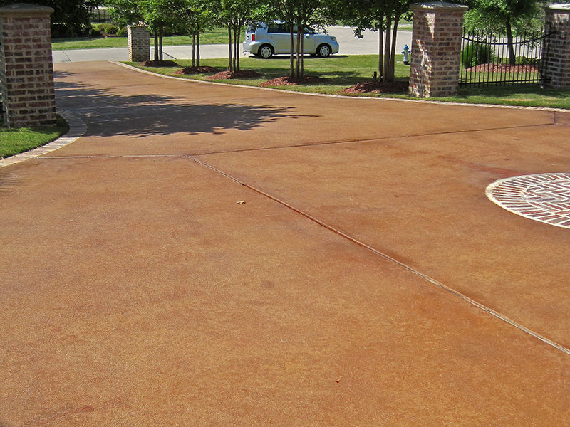 looking down an umber acid stained driveway