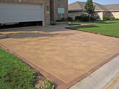 brown stained skim coat overlay on driveway