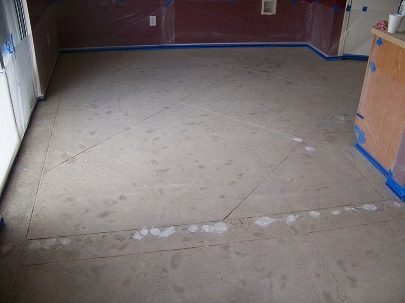 patched tack strip holes in floor prior to acid staining