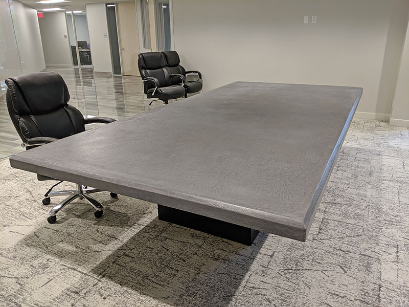 side view of gray concrete conference table
