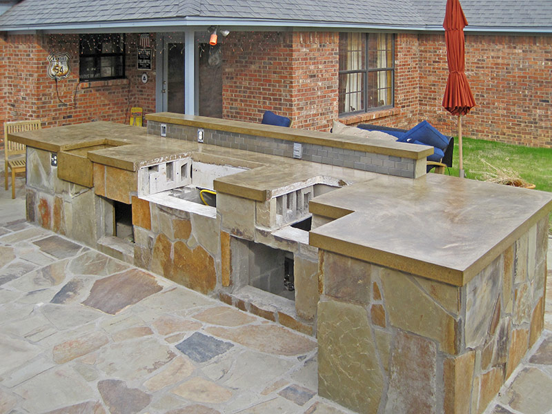 side view of outdoor kitchen with concrete countertops