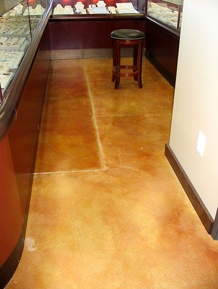gold acid stained patched floor