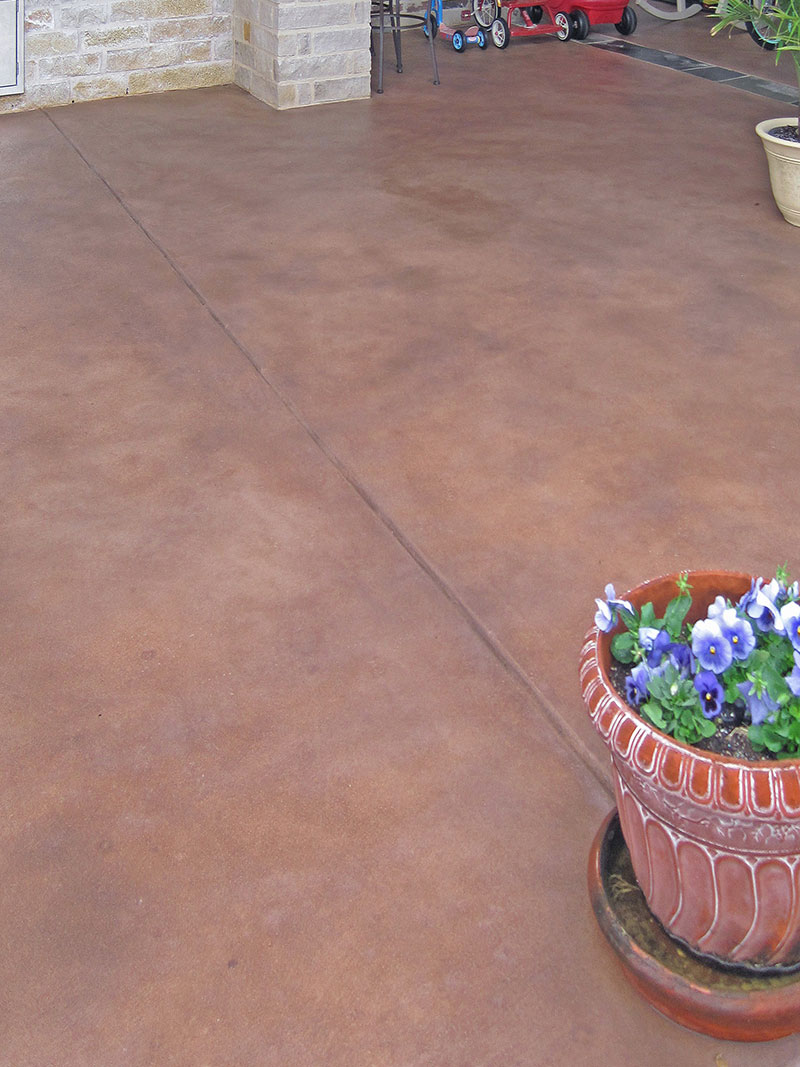 skim coat on patio with flower pot