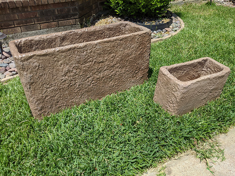 side view of two short rectangular concrete planters