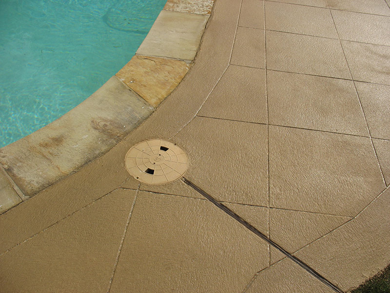 closeup of skim coat overlay with tile pattern