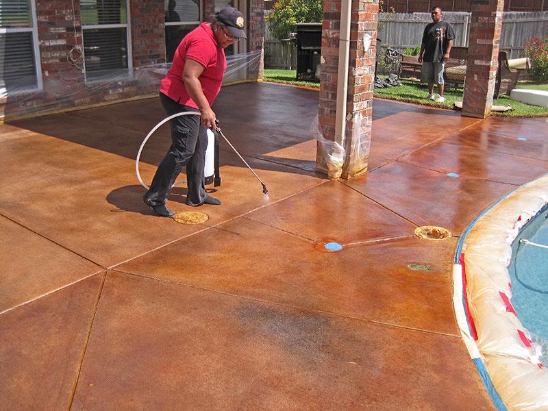 applying second coat of sealer to pool deck