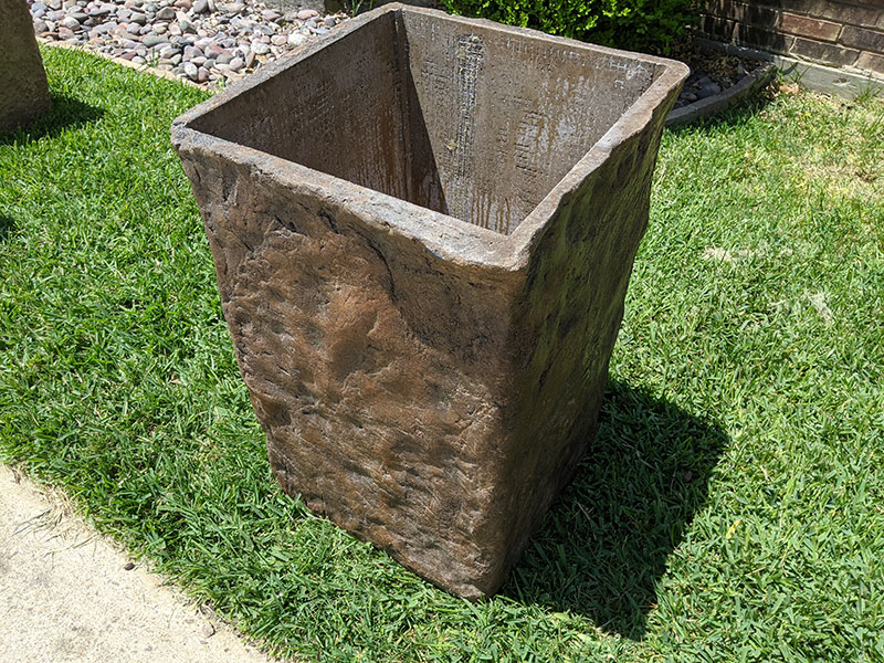 side view of tall rectangular concrete planter