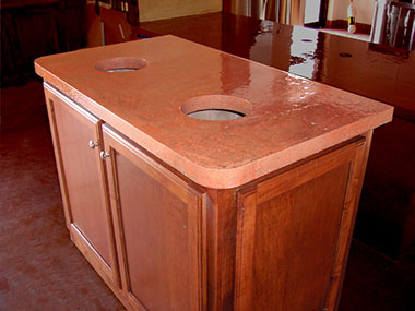concrete trash receptacle with a terracotta water stain