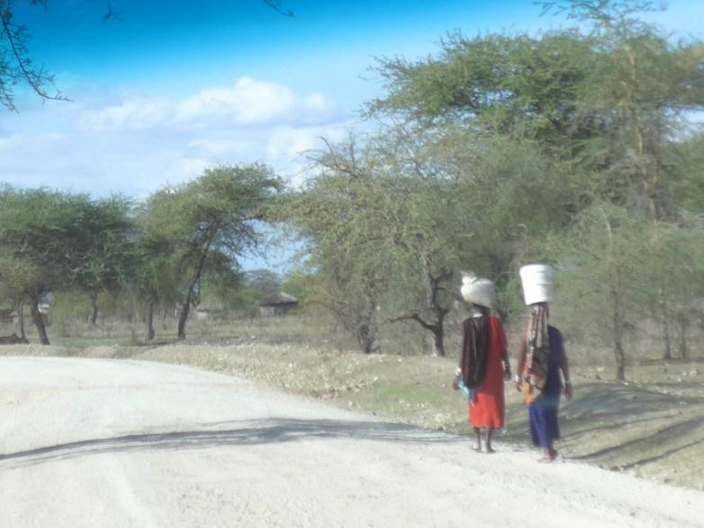 Maasai women carrying baskets on head