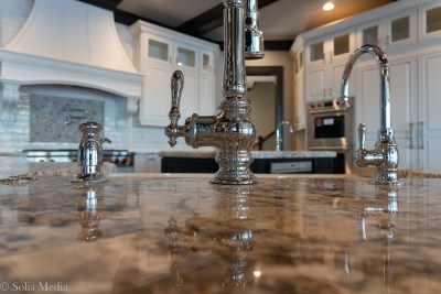 Preissless Design Interior Design - Lake Oconee property - kitchen fixtures - photography by Solia Media