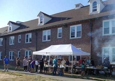 OneLife Community Church BBQ tent, with a line of hungry customers