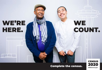 """US Census poster picturing two men w/ the text: """"We're here, we count."""""""