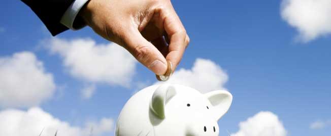 adding coins to piggy bank