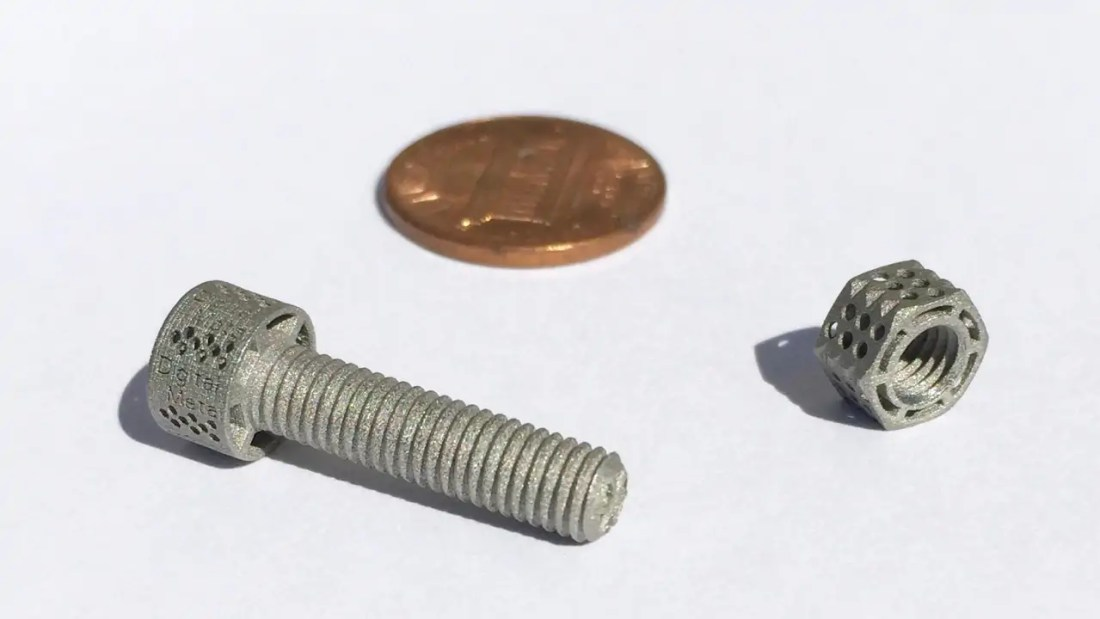 Tiny 3D printed metal nut and bolt of exceptionally low weight due to 3D design