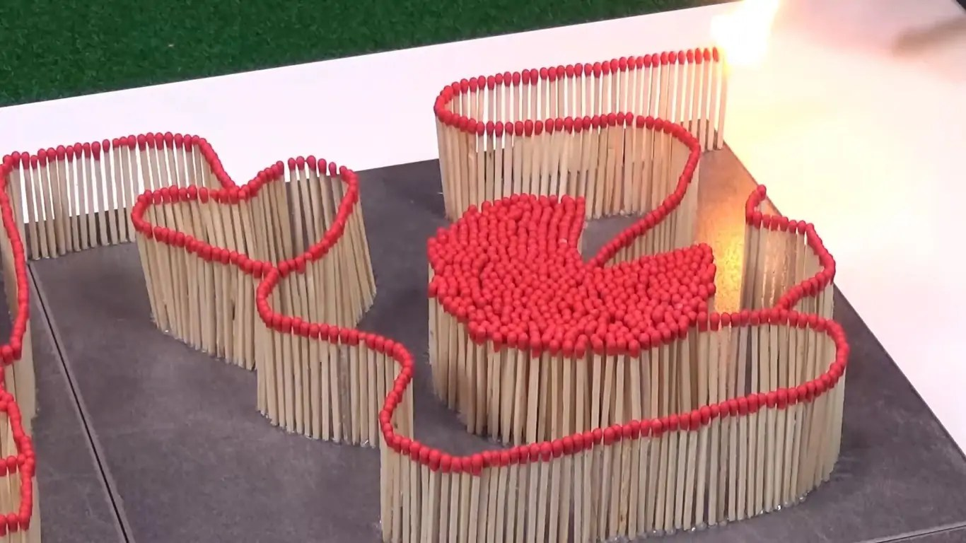 This Bonkers Take on the Classic Domino Chain is Made From 5,000 Sizzling Match Sticks