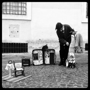 Puppeteer and marionette in Piazza Sta Maria de Trastevere, Rome