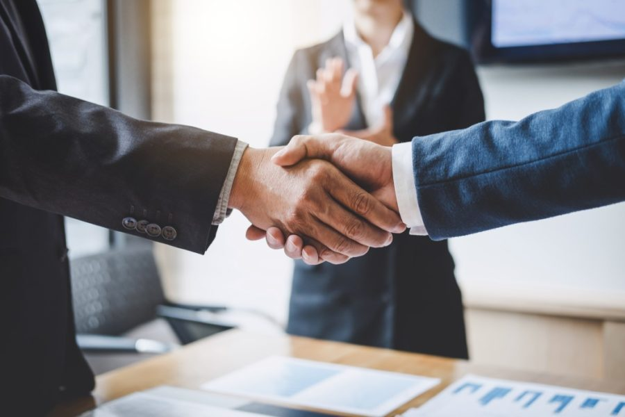 finishing-up-a-meeting-business-shaking-hands-after-discussing-good-deal-of-trading-to-sign-agreement_t20_ZV0Lnb