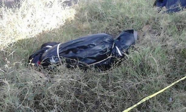 Hallan el cadáver embolsado de una persona en una carretera de Olocuilta, La Paz