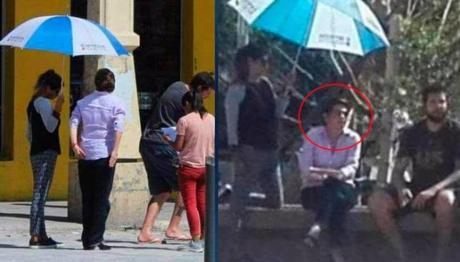 Critican a Jackeline Rivera por delegar a una persona para que la cubra del sol mientras camina en el centro de San Salvador