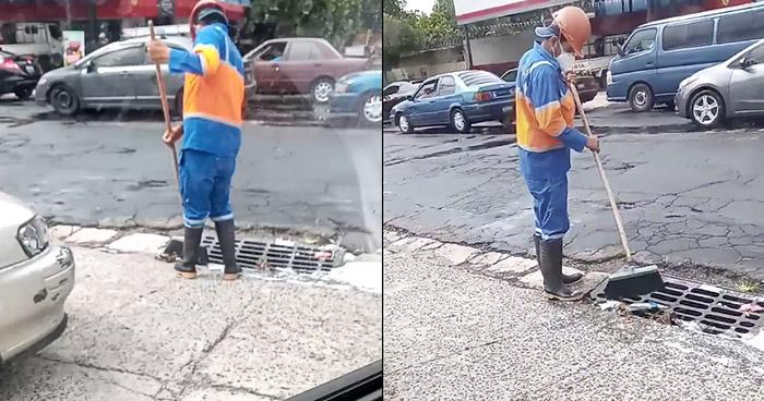 Captan a empleado de la alcaldía de San Salvador lanzando basura en alcantarilla