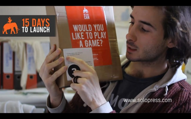 We Are CAN founder Damiano Marchetti opens printing package from Solopress