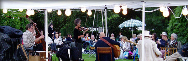 Band (including violin and chello) play in a marquee at the beautiful gardens at Gibberd Gardens