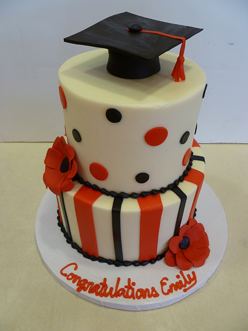 Red white and black graduation cake.