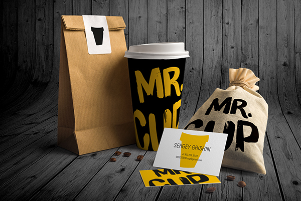 Collage of Coffee Cup design for Mr. Cup - shows a brown paper bag, a coffee cup with 'Mr. Cup' written on it in yellow with a black background, and a business card for the owner
