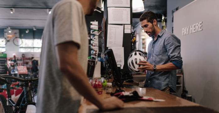 upsell bike helmet at counter