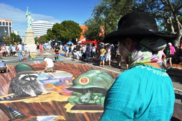 Artist Tracy Lee Stum during the 2013 Sarasota Chalk Festival, Florida, Nov. 17, 2013