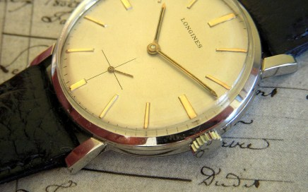 A vintage watch laid out on a hand-written letter.