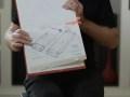 Marc Porat, Founder and CEO of General Magic, displays his 1989 drawings of the Smart Phone he imagined. Still taken from GENERAL MAGIC, directors Matt Maude and Sarah Kerruish.